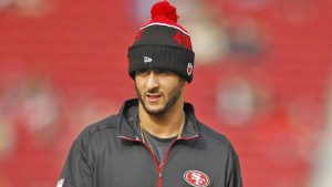 Colin Kaepernick takes a stand by not standing for the national anthem