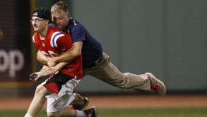 LOOK: Boston fan in Harambe jersey runs on field at Fenway, gets form-tackled
