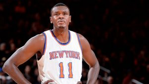 Ex-NBA player Dalembert charged with battery
