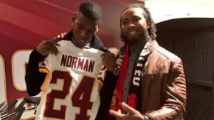 LOOK: Redskins+ACYAIw-039+ADs Josh Norman brings Man. United+ACYAIw-039+ADs-s Paul Pogba to postgame podium