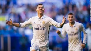 Ronaldo hat-trick keeps Real top