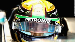 Hamilton keeps title hopes alive with pole start