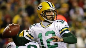 Packers' Rodgers will play despite having pain