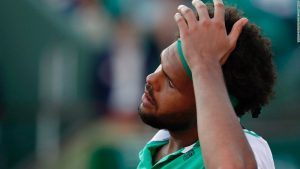 French hope Tsonga ousted at Roland Garros
