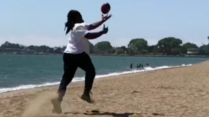 WATCH: Marshawn Lynch shows off crazy footwork while wearing boots at the beach