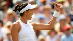 Muguruza overpowers Williams to win first Wimbledon