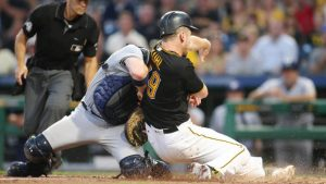 Rare home plate collision forces Brewers' Stephen Vogt out of the game with an injury