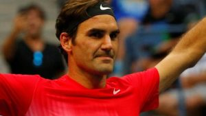 Federer beats Youzhny in five sets to reach third round