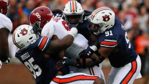 With dominant play, Auburn making once-unthinkable playoff case for two-loss teams