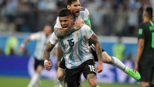 Argentina and Messi scrape into World Cup's last 16